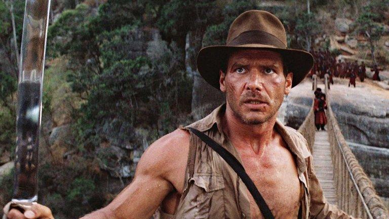 """""""Индиана Джоунс""""  Да, тези филми всички сме ги гледали. Да, те дори са лесни за намиране в Netflix. И все пак, ако има нещо, което гарантирано ще ви разведри дори след толкова повторения, това са историите за любимия археолог на планетата - Индиана Джоунс. Той не е типичен герой, дори напротив - лудориите и измамите не са му чужди, но всичко в името на науката. Приключенията с кивота на Завета, свещените индийски камъни и със Светия Граал ги знаем всички, но още едно гледане не пречи."""