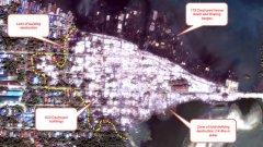 В дясната част на снимката се виждат обгорелите остатъци от квартала, в който са живеели мюсюлмани