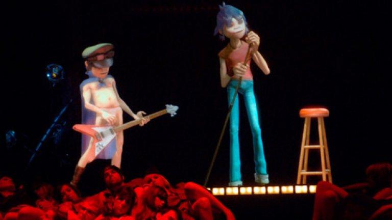 """Gorlillaz  Тук случаят е по-различен и не става въпрос за мъртви легенди, а за най-известните виртуални музиканти – Gorillaz на Деймън Олбърн. Дебютът им беше през 2001 г., когато истински музиканти свириха вместо тях зад прожекционен екран. За щастие пет години по-късно, когато те се изявиха на наградите """"Грами"""" заедно с Мадона, технологията вече беше доста напреднала. Gorillaz все още са активни и през този месец Олбърн ще започне работа по петия им студиен албум."""