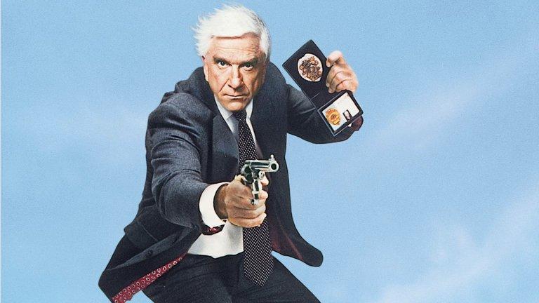 """The Naked Gun/ """"Голо оръжие""""  И все пак ако има един агент на закона, в който никога не трябва да се съмняваме, това е лейтенант Дребин. Героят на невероятния Лесли Нилсен и един от най-запомнящите му се пародийни филми - """"Голо оръжие"""", са перфектно решение за мрачното настроение. Освен """"Голо оръжие"""" тук можете да заложите на """"Робин Худ: Мъже в чорапогащи"""", """"Животът на Браян"""" или """"Светия Граал"""" на Монти Пайтън, както и редица други нелепи комедии."""
