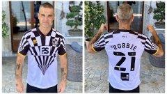 Обяснено: Защо Роби Уилямс се зае с дизайна на екипите на клуб от четвърта дивизия?