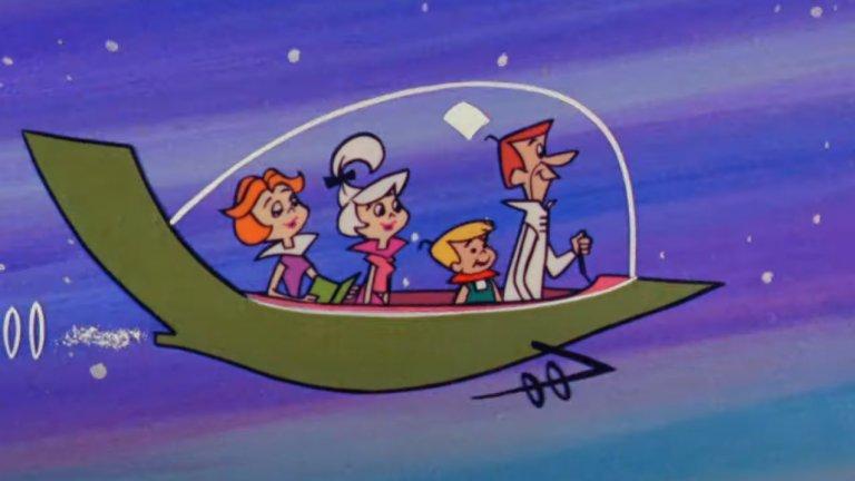 """The Jetsons/ """"Семейство Джетсън""""  Макар и видимо да използва същата формула като """"Семейство Флинтстоун"""", историята на """"Семейство Джетсън"""" става не по-малко популярна, а един от най-известни кросоувъри в телевизията е именно между двете семейства, които разменят местата си във времето.   Най-интересното от днешна гледна точка е начинът, по който през 60-те са си представяли бъдещето с летящи коли и градове във въздуха."""