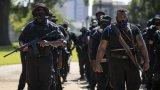 Групата, съставена само от въоръжени чернокожи, заявява, че не търси насилие, но според критиците им насилието може само да намери NFAC