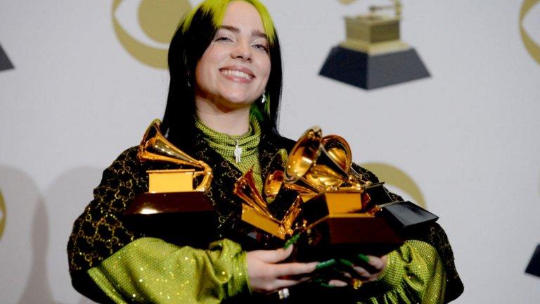 """Били Айлиш  Били Айлиш е първата жена, която взима четирите най-големи награди """"Грами"""" – за албум на годината, за запис и песен на годината и за най-добър нов изпълнител."""