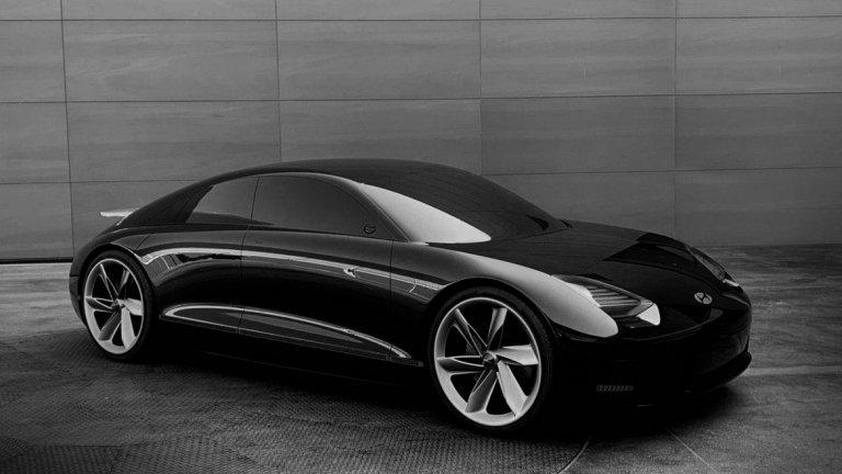 Hyundai Prophecy   Prophecy щеше да бъде интересна гледка на живо, особено след като за представянето на автомобила на пътя не се знае почти нищо. Наясно сме, че това е поредният концептуален модел на Hyundai, с който компанията тренира за електрическото бъдеще, облечено във впечатляващ дизайн.   Автомобилът наистина изглежда футуристично, не само на външен вид. Колата няма волан и се управлява с джойстици, ако управление от човек въобще й е необходимо - амбициите са да е напълно автономна. Почти всяка повърхност от интериора е заета от тъчскрийнове, с един голям инфотейнмънт диспей отпред.  Засега няма информация дали въобще има някакъв шанс Prophecy да влезе в серийно производство, или към момента създателите му гледат на него като на красив, но твърде голям риск за фирмата.
