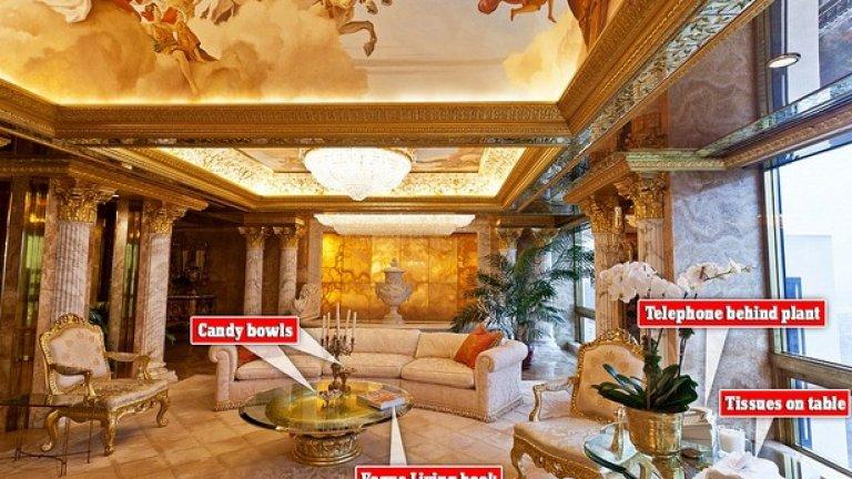 Насред дневната има фонтан, а пред него - диван с цвят слонова кост. Кристален полилей и изображение на Аполон с колесница допълват картинката