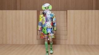 """Това може и да прилича на Пениуайз, клоуна от """"ТО"""", но всъщност е модел от Paris Fashion Week, представящ тенденциите в мъжката мода. Ако смятате, че лъмбърджак стилът е прекалено мъжествен за вас, винаги може да пробвате яркозелена перука под бяло таке. Със сигурност ще стои интересно."""