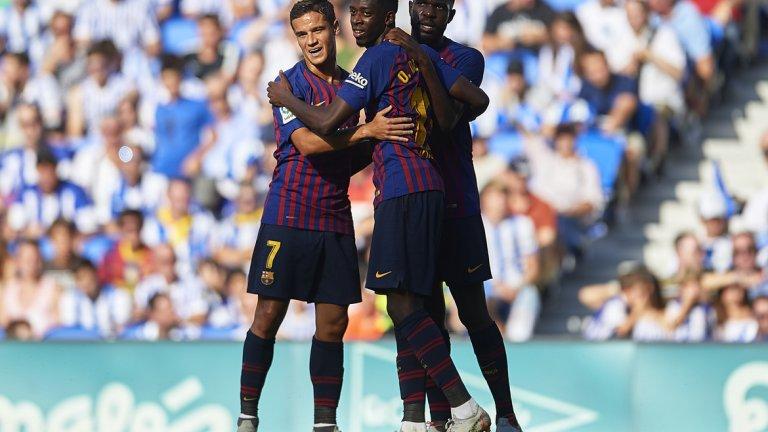 Дембеле се радва с Юмтити и Коутиньо след отбелязването на победния гол