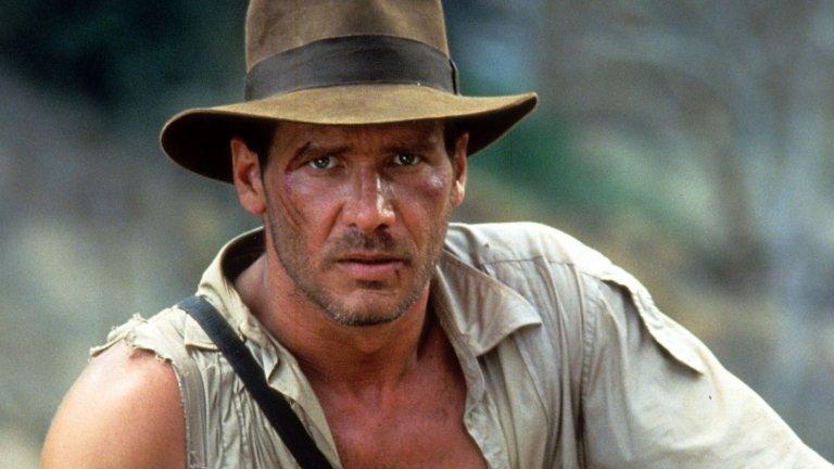 """""""Индиана Джоунс""""  Продължаваме с вълната от филми на Спилбърг. Харисън Форд е перфектен като археолога Индиана Джоунс - човек, който трудно се задържа пред черната дъска и вместо това е изненадващо ефективен """"на терен"""" - с камшик и пистолет в ръка, борещ се с култове, нацисти и какво ли още не.  Оригиналната трилогия е неповторимо приключение, което ще ви пренесе из различни точки на света.  И тук правим уточнението, че четвъртият филм - """"Индиана Джоунс и кралството на кристалния череп"""", е нещо, което можете спокойно да пропуснете, тъй като може да развали приятните ви впечатления."""