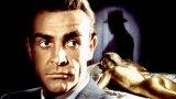 """""""Голдфингър"""" (Goldfinger, 1964) Бонд е: Шон Конъри  Ваканцията на Агент 007 след успешна мисия бързо се превръща в поредната задача, когато му се налага да разследва магната Орик Голдфингър и конспирация около мащабен контрабанден износ на злато.   """"Голдфингър"""" е третият от поредицата и най-успешният до онзи момент, не само заради по-големия си бюджет. Това е филмът, в който създателите на Бонд сякаш откриват успешната формула за героя и много от характерните неща, които правят поредицата успешна - от хумора, включително в имената на персонажите, до технологичните джаджи, които шпионинът използва. Очаква ви и една от най-култовите реплики за цялата поредица:  - Очакваш да говоря ли? - Не, г-н Бонд. Очаквам да умрете."""