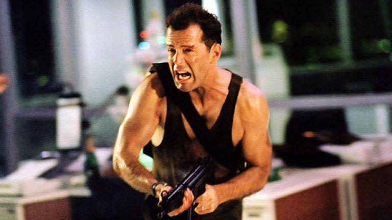 """Умирай трудно (1988)  Еталонът за вълнуващ и остроумен екшън хит. Семплата концепция, в която циничният полицай Джон Маклейн прочиства отряд терористи един по един, спасява заложници и ръси незабравими реплики, се сдобива с безкрайни имитации и пародии, до една без заряда и ефективността на """"Умирай трудно"""".  Самият Брус Уилис се храни от ролята до ден днешен, но без шанс да достигне същата висота."""