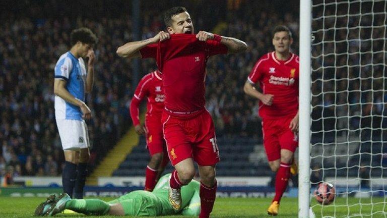 """Коутиньо захапа фланелката си след победния гол, пратил Ливърпул на """"Уембли""""."""
