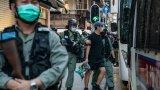С него се криминализира всякаква подривна дейност и опити за отцепване от централата китайска власт (на снимката: арестуван мъж по време на продължаващите анти-правителствени протести в Хонконг)