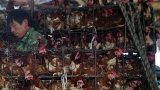 Това е 57-годишна продавачка на месо на пазара за животни в Ухан