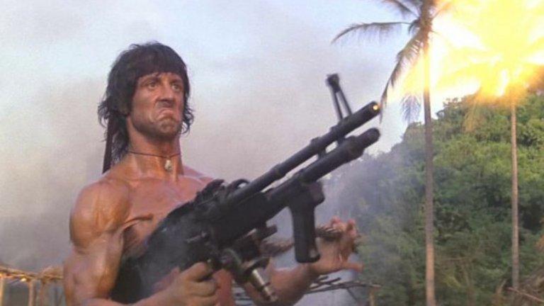"""""""Рамбо: Първа кръв II"""" (Rambo: First Blood II, 1985 г.)  След като за ветерана от Виетнам собствената родина е била врагът в първия филм, време е гневът и уменията му да бъдат насочени към СССР. Джон Рамбо (Силвестър Сталоун) е освободен от затвора и върнат отново във Виетнам в търсене на военнопленици. Естествено, намира още по-големи неприятности. Трябва да се отбележи, че тук не само комунистите (представени от садистичния полковник Подовски и неговия бияч сержант Юшин) са лошите, но в някаква степен и американското правителство, което Рамбо продължава да вини за своето положение и това на други ветерани. Във всички случаи обаче, ако човек реши да гледа филм за Рамбо, е най-добре да се ограничи само до първия."""