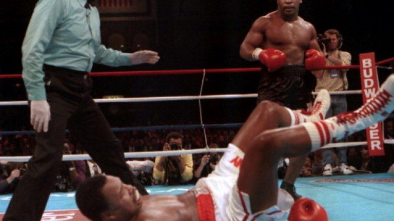 7 секунди преди края на четвъртия рунд Тайсън праща Холмс за трети път в нокдаун и печели мача