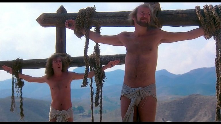 """Monty Python - Always Look On The Bright Side Of Life (""""Животът на Брайън"""") Що се отнася до яки песни от филми, които носят специфично настроение, малко са тези, които могат да се мерят с Always Look On The Bright Side Of Life. Тя безспорно е великолепна, също както и самият филм """"Животът на Браян""""."""