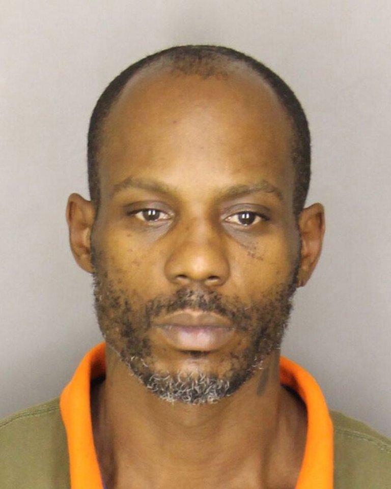Снимка на Симънс от негов арест през 2013 г.