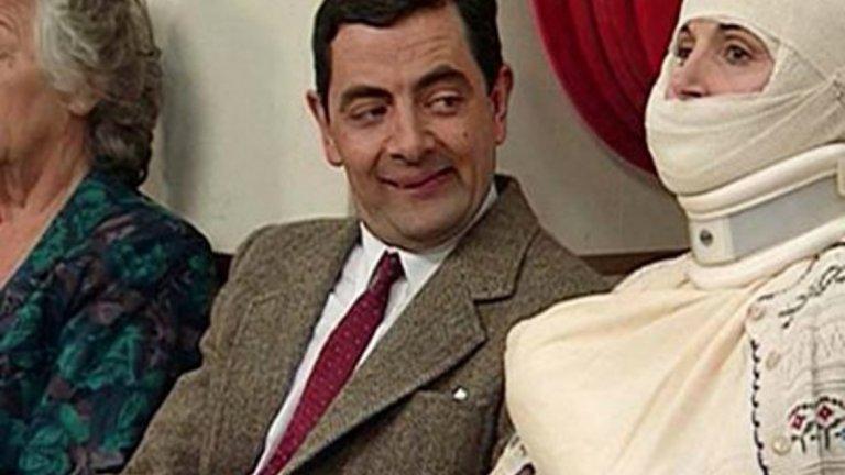 """Mr.Bean  """"Мистър Бийн"""" е от онези явления, които могат да осигурят прехрана на един актьор до края на дните му. Със сигурност сте виждали персонажа на Роуън Аткинсън, но все пак ще уточним, че става дума за """"дете в тялото на зрял мъж"""" - човек, който в опита си да се справи с ежедневни задачи се забърква в неприятности и създава неудобства за околните. Вдъхновен от физическата комедия на актьорите от нямото кино, в началото на 90-те Аткинсън създава един от символите на британската комедия, който е популярен и до днес."""